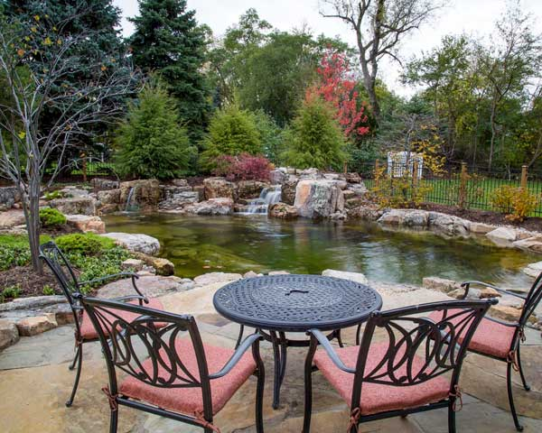 Natural Look water feature with patio, Authentic Homescapes